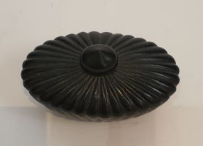 An oval Chinese green stone lidded bowl with a gadrooned design and tear drop finial. H.12xW.8cm