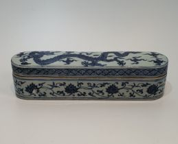 A Chinese blue and white glazed porcelain lidded box for calligraphy tools, decorated with a five