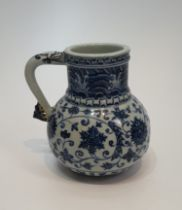 A Chinese blue and white Islamic market pattern porcelain jug/tankard with scrolling form handle