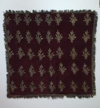 A 19th century Ottoman plum velvet textile embroidered with a repeating floral design in silver