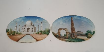 A large pair of antique Indian ivory plaques, each hand painted, one of the Taj Mahal and the