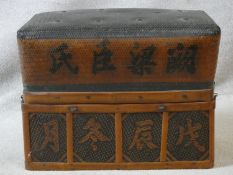 An antique Japanese woven straw lidded box with character mark decoration and metal studding to