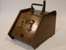 A 19th century walnut coal box with Art Nouveau style embossed brass decoration and with original