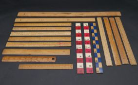 A collection of seventeen vintage wooden rulers, some with makers marks and stamps. L.61cm (Longest)