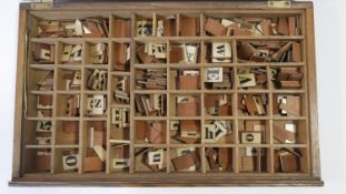 A large collection of vintage wooden backed spelling letters, symbols and numbers in various type