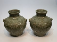 A pair of Chinese green celadon crackle glaze porcelain vases. Decorated with flowers and with