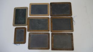 A collection of eight vintage wooden framed chalkboards, some slate. H.28 W.20cm (Largest)