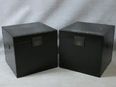 A pair of hinged lidded lacquered boxes with metal clasps and carrying handles and lined
