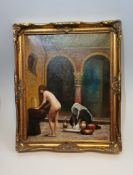 A gilt framed Eastern oil on canvas of a nude female washing clothes in a fountain. Unsigned. H.