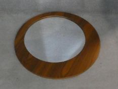 A contemporary wall mirror with off set circular plate. D.75cm