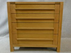 A contemporary pegged and jointed oak chest of four long drawers. H.88 W.90 D.46cm