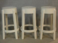 Three high stools stamped Charles Ghost by Kartell with Starck. H.66cm