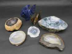 A collection of moss agate, banded agate and chalcedony carved dishes along with a carved sodalite