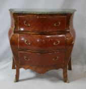 A French bombe style kingwood and inlaid commode with marble top and ormolu mounts on cabriole