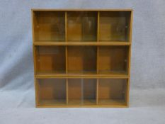 Three mid century vintage teak Unix sectional stacking bookcases with twin glass sliding doors and