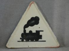 A vintage road sign with enamelled and embossed train warning. H.82 W.92cm