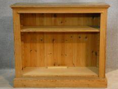 A Victorian style pine dwarf open bookcase. H.87 W.101 D.37cm