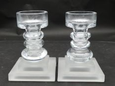 A pair of glass candlesticks with frosted glass square pedestal bases. H.21 L.15 W.15cm