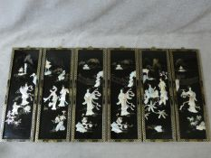 Six Japanese black lacquered mother of pearl inlaid panels with gilded painted details and floral