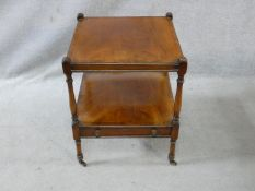 A late 19th century mahogany and crossbanded lamp table on turned supports united by undertier