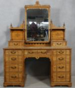 A late 19th century Aesthetic style walnut dressing table with incised carved decoration and ebony