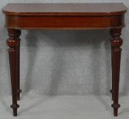A 19th century mahogany console table fitted with frieze drawer on tapering fluted supports. H.72
