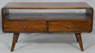 A mid century vintage teak low table fitted with base drawers on dansette supports. H.46.5 L.89.5