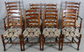 A set of eight oak Lancashire ladderback dining chairs in floral upholstery on turned stretchered