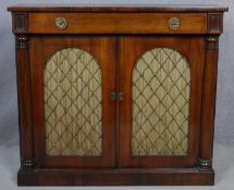 A Regency rosewood chiffonier with frieze drawer above arched metal grille doors and pleated silk