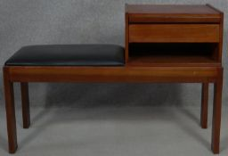 A 1970's vintage teak telephone table with pull out laminated directory board marked; Original