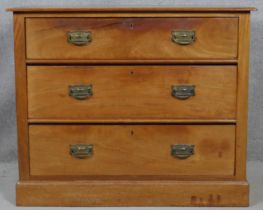 A late 19th century walnut chest of three long drawers on plinth base. H.77 W.92 D.53cm