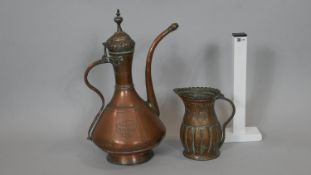 An 18th century copper samovar and vintage gadrooned copper jug. The samovar has a snake form handle
