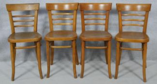 A set of four mid century beech bentwood cafe style chairs. H.78cm
