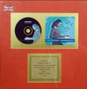 A framed producers presentation for sales of 400,000 copies of Brimful Of Asha by Cornershop. H.41