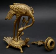 A Meiji period Japanese gilt bronze candle stick in the form of a Manchurian crane standing on a