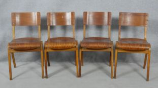 A set of four mid century vintage laminated ply stacking chairs with patent stamp for Tecta