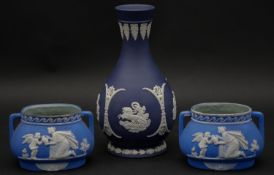 Three pieces of 20th century blue and white Wedgwood Jasperware. Including a pair of two handled