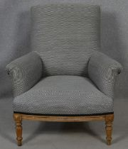 A C.1900 oak framed upholstered armchair on turned supports. H.94 W.83 D.79cm