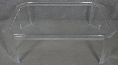 A late 20th century designer clear lucite coffee table. H.38.5 L.120 W.79cm