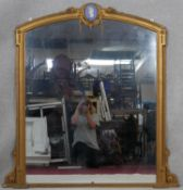 A late 19th century gilt overmantel mirror with Classical style Jasperware intaglio to the