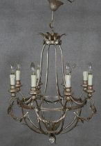 An eight branch ceiling chandelier with scrolling foliate metal frame. Dia.64cm