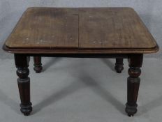 A Victorian mahogany extending dining table on tapering fluted supports. H.64 L.106 W.104cm (