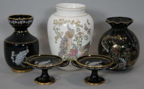 A collection of Greek ceramic pieces with 24 carat gold detailing, decorated with peacocks. Makers