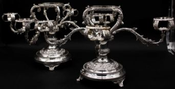 A pair of silver plated four branch centre pieces with scrolling foliate and floral motifs. Stamps
