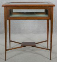 An Edwardian mahogany, satinwood crossbanded and ebony strung vitrine on square tapering supports