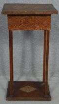 An Arts and Crafts carved work box on stand. H.60 L.32 W.24.5cm