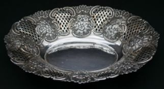 A Victorian sterling silver repousse pierced work dish with lattice work panels, floral and