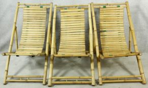 Three bamboo and slatted deck chairs. H.96cm (one in need of repair as photographed).