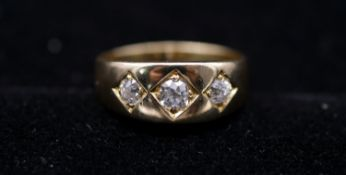 A Victorian 18 carat yellow gold and diamond three stone gypsy ring. Set to centre with a cushion