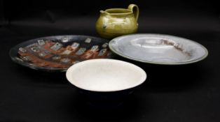 Three pieces of Art Pottery and a Murano style glass bowl. A green glaze jug with roundels, a